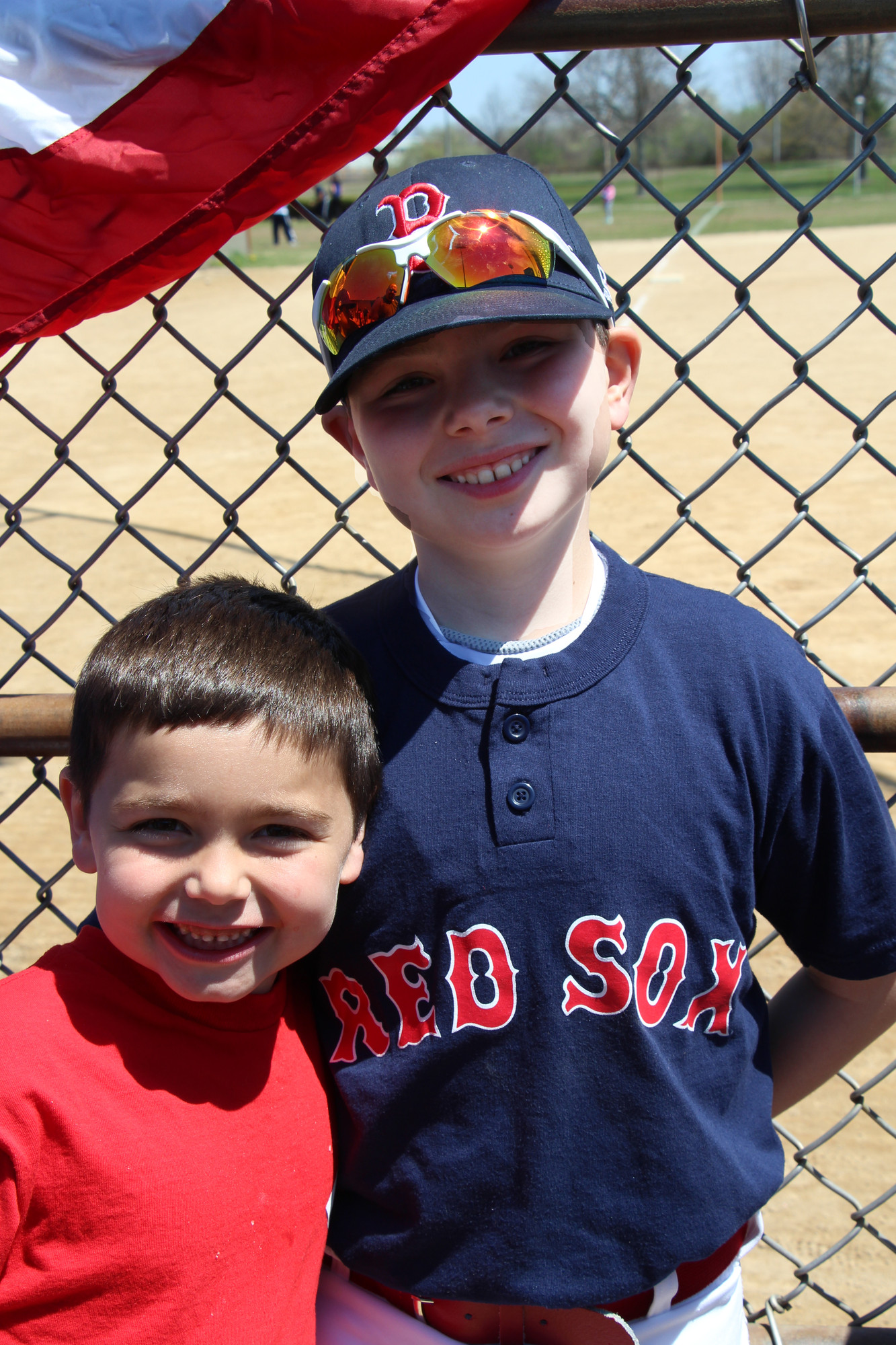 The Carney Brothers Ryan, 7, of the Reds  and John Jr., 10, who plays for the Red Sox were all smiles.