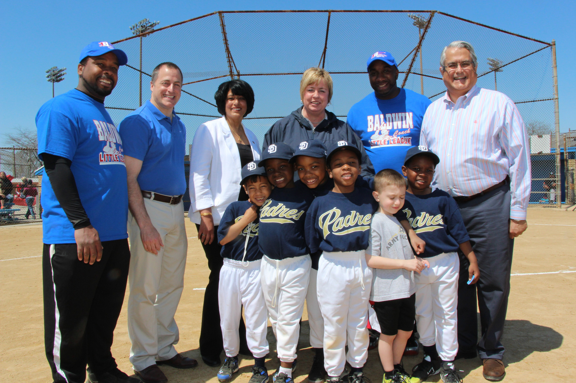 Baldwin Little League held its annual Opening Day cermonies on May 3 at Baldwin Park and it was quite the success, with a large turnout and sunny skies. Pictured from the Padres, a team of 6 and 7 year olds, were, from left. Garri Williams Jr., Cameron Myles, Luke Freymann, Benjamin Addzi, Jordon Andreula and Jayden Johnson. The back row from left is coach Garris Williams,  Assemblyman Brian Curran, Town of Hempstead Clerk Nasrin Ahmad, Town of Hempstead Supervisor Kate Murray, coach Lateef Williams and Town of Hempstead Councilman Anthony Santino.