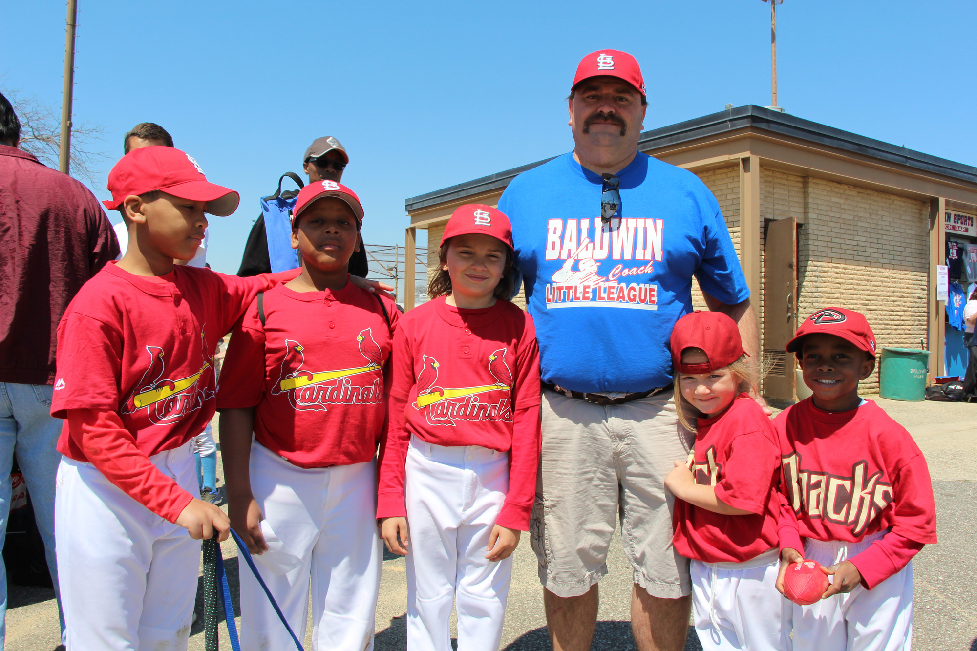 Coach Bill Dworsak of the Cardinals posed with some of the little league players. From left were Cameron Payton, 10, Rodney Dartois, 10, Jesse Dworsak, cardinals, 10, Briana Dworsak, 4, Darius Nelson, 5.