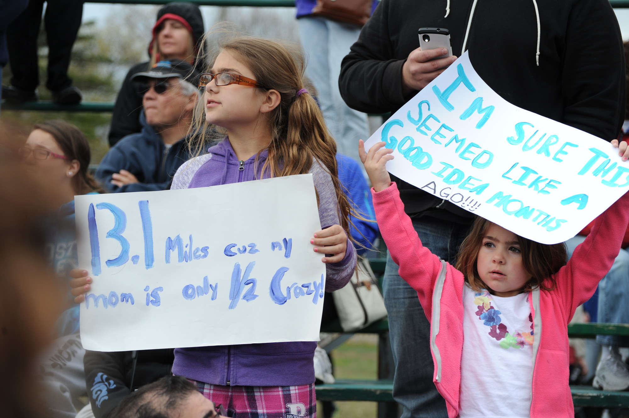 Julia Monte, 9, and sister Carly, 5, held signs of encouragement ... sort of.