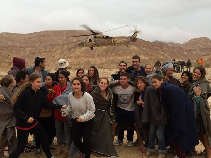 Israeli rescue services used helicopters and jeeps to evacuate a student group that was caught in a flash flood in the southern Negev desert.