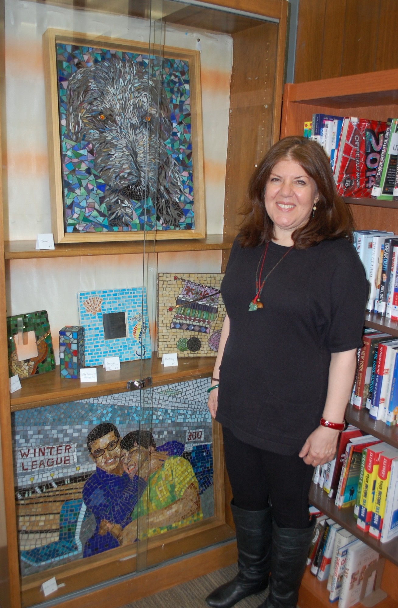 Helen Harris, a 59-year resident of Valley Stream, has her mosaic artwork on display at the Waldinger Library in May.