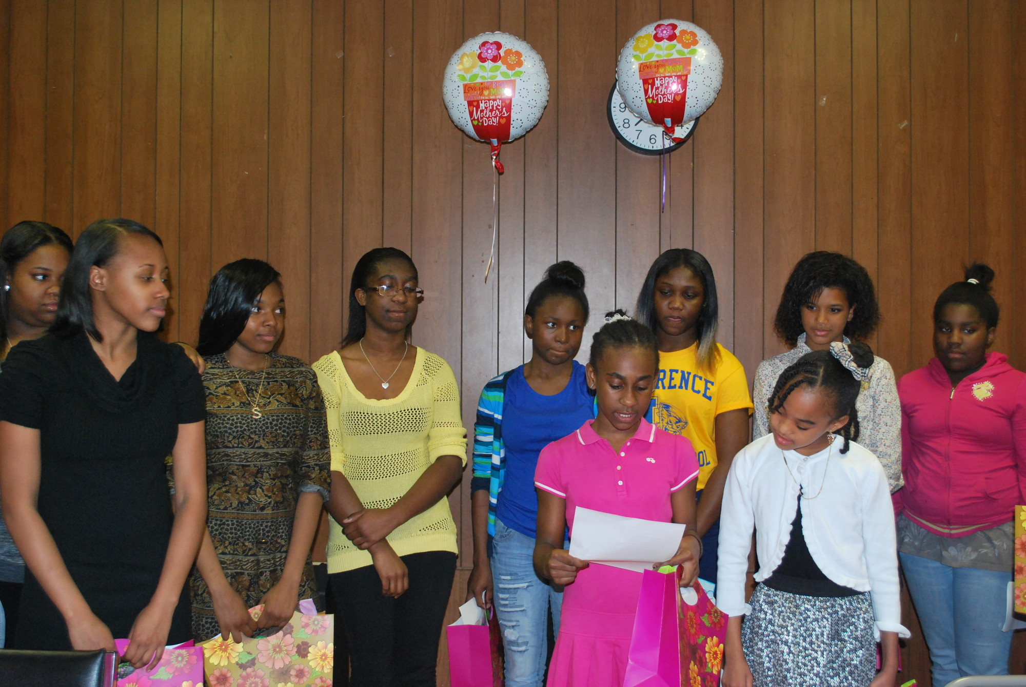 Mother's Day was celebrated early as girls in the fifth through 12th grades honored their moms and other relatives on May 8 during a dinner at the Five Towns Community Center. Fifth-grader Dana Best thanked her mother for being supportive.