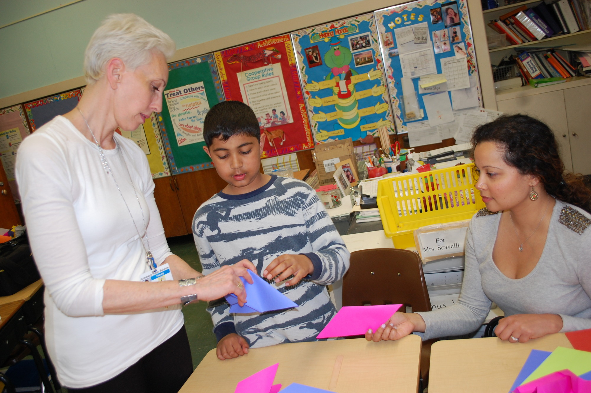 Instructor Leah Bernstein helped Daniel Amin, a fourth-grader at the Willow Road School, and his mother, Savita, with their origami project at District 13's Explorations Day on May 5.
