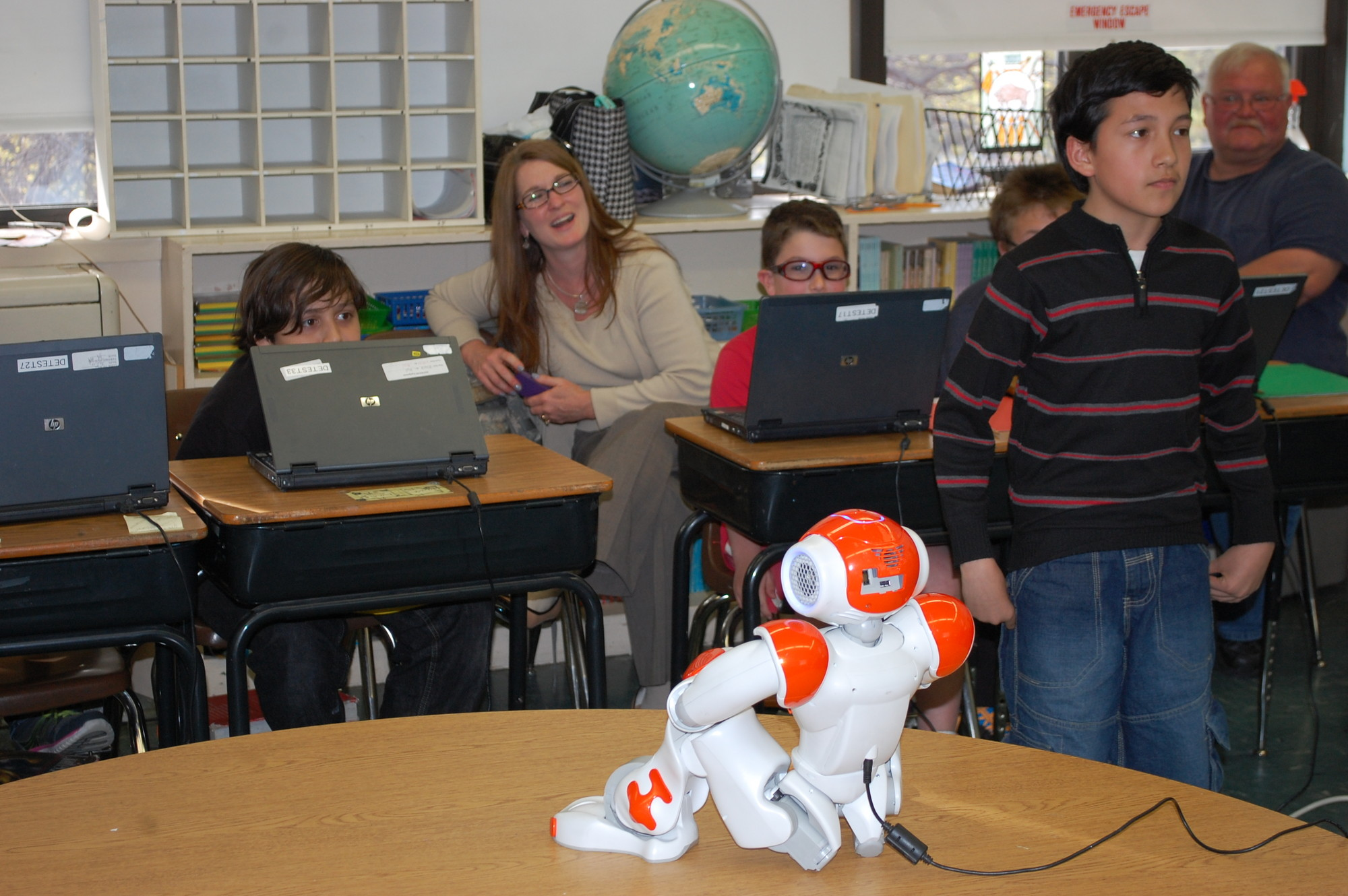 Students from the district's gifted and talented program, along with their parents, were able to learn about robots.