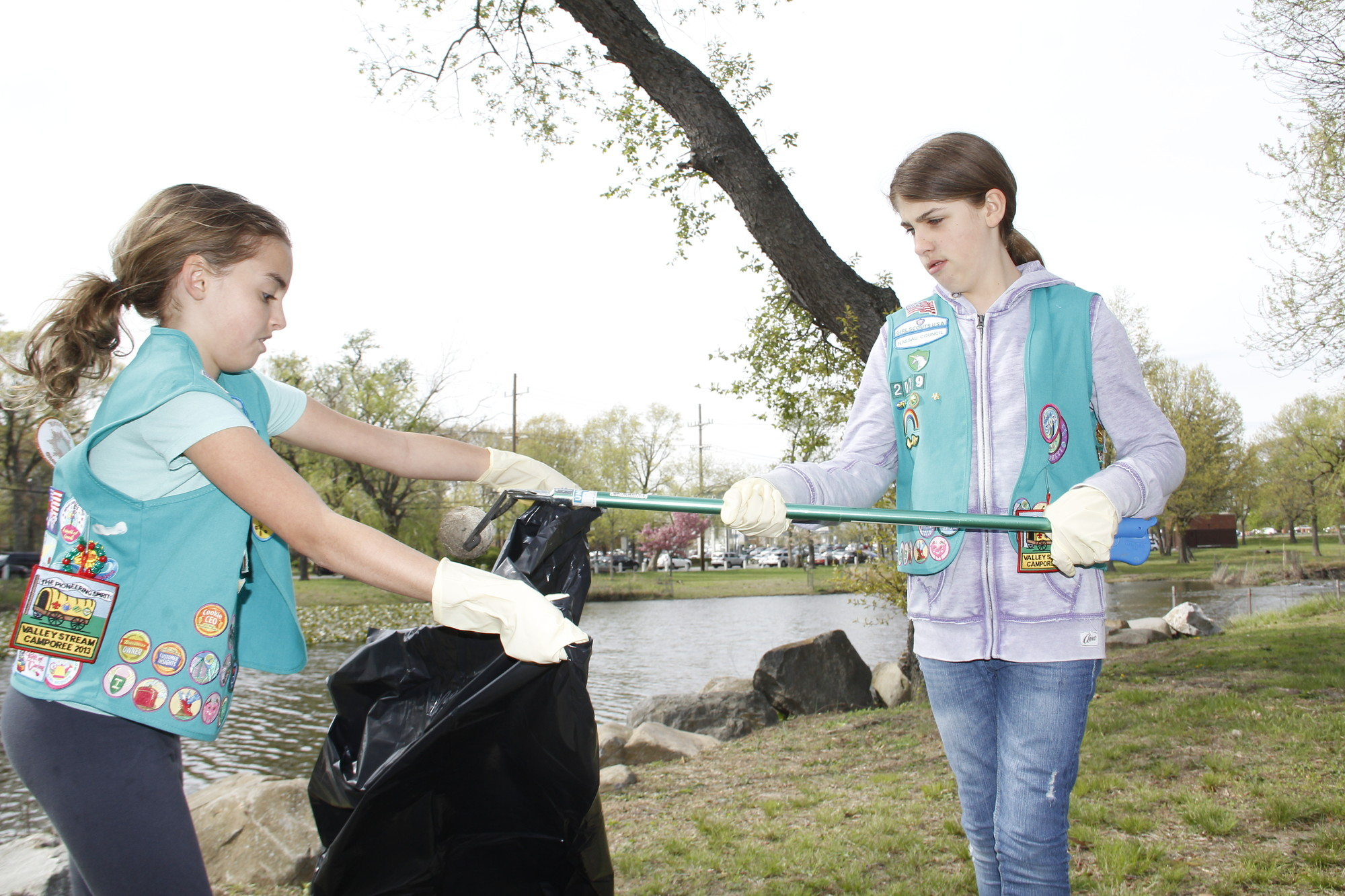 Sara Schaefer and Bridget Sharp from Troop 2029 did their part to help clean up Cahill Park in Valley Stream.