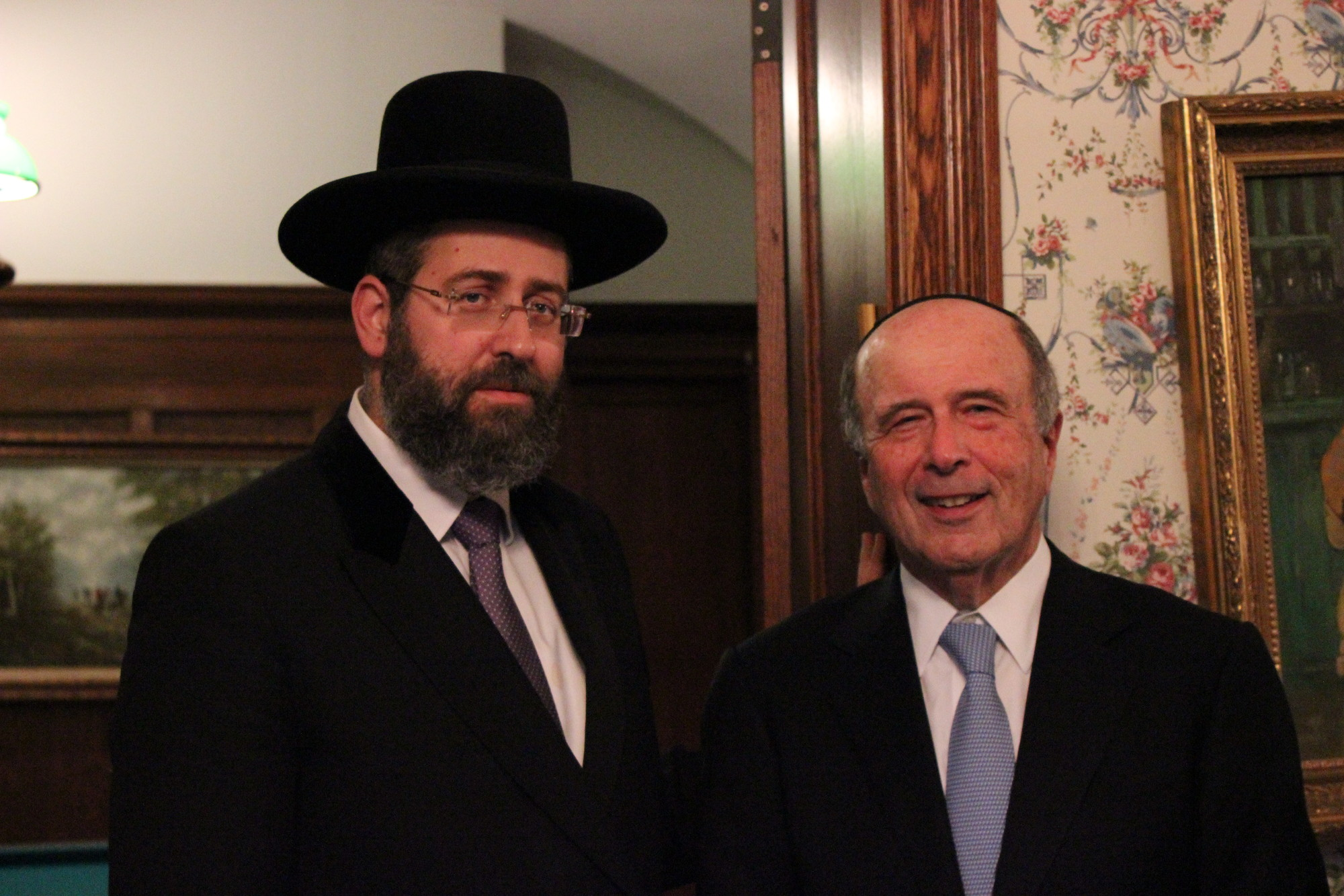 Village of Lawrence Mayor Martin Oliner, right, hosted the chief rabbi of Israel, David Lau, in his Central Avenue home Monday.