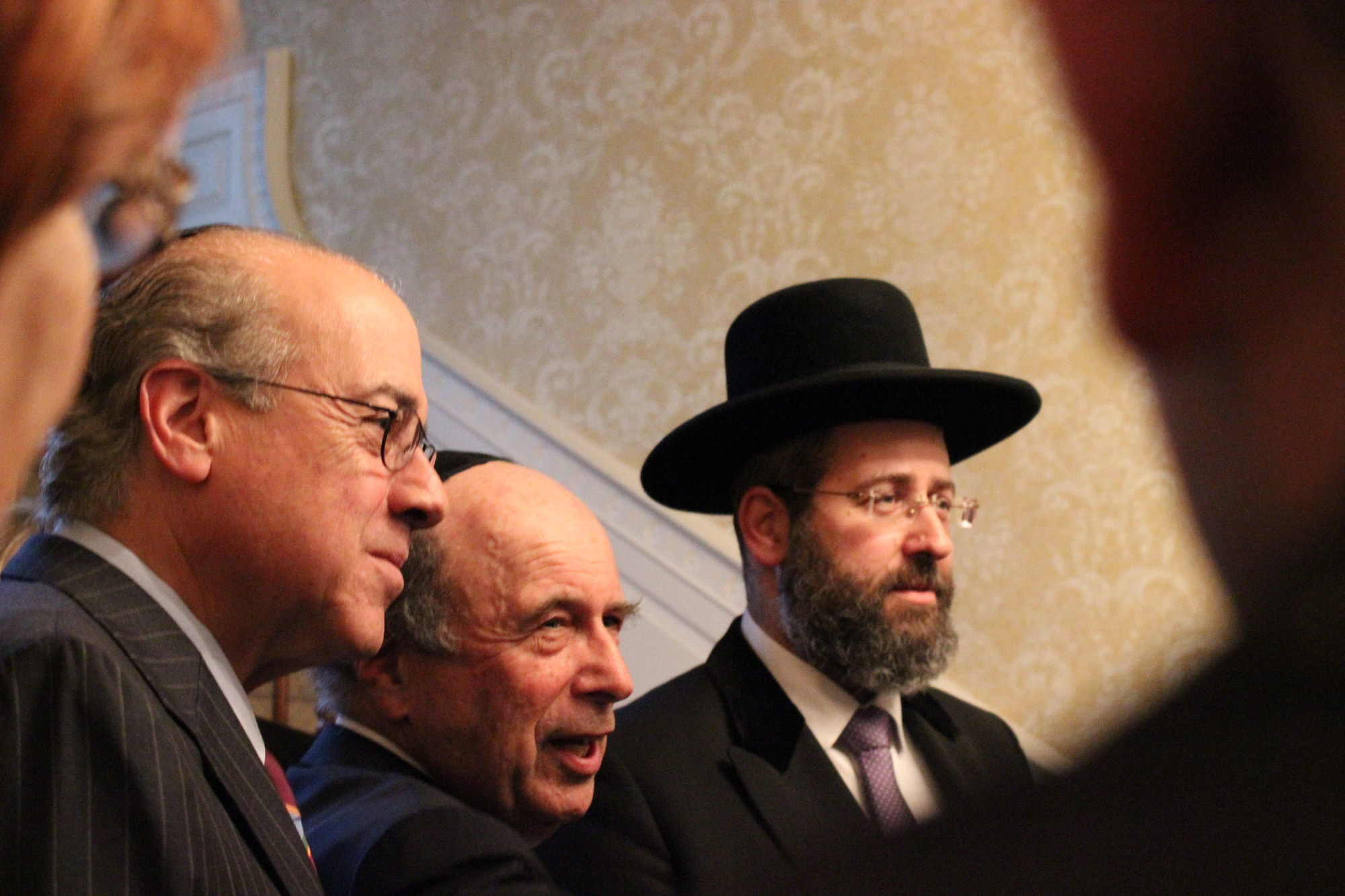 Israel's chief rabbi, greeted more than a hundred religious leaders and other guests at the home of Martin Oliner, the mayor of Lawrence village. From left were Rabbi Jay Rosenbaum, Oliner and Chief Rabbi David Lau.