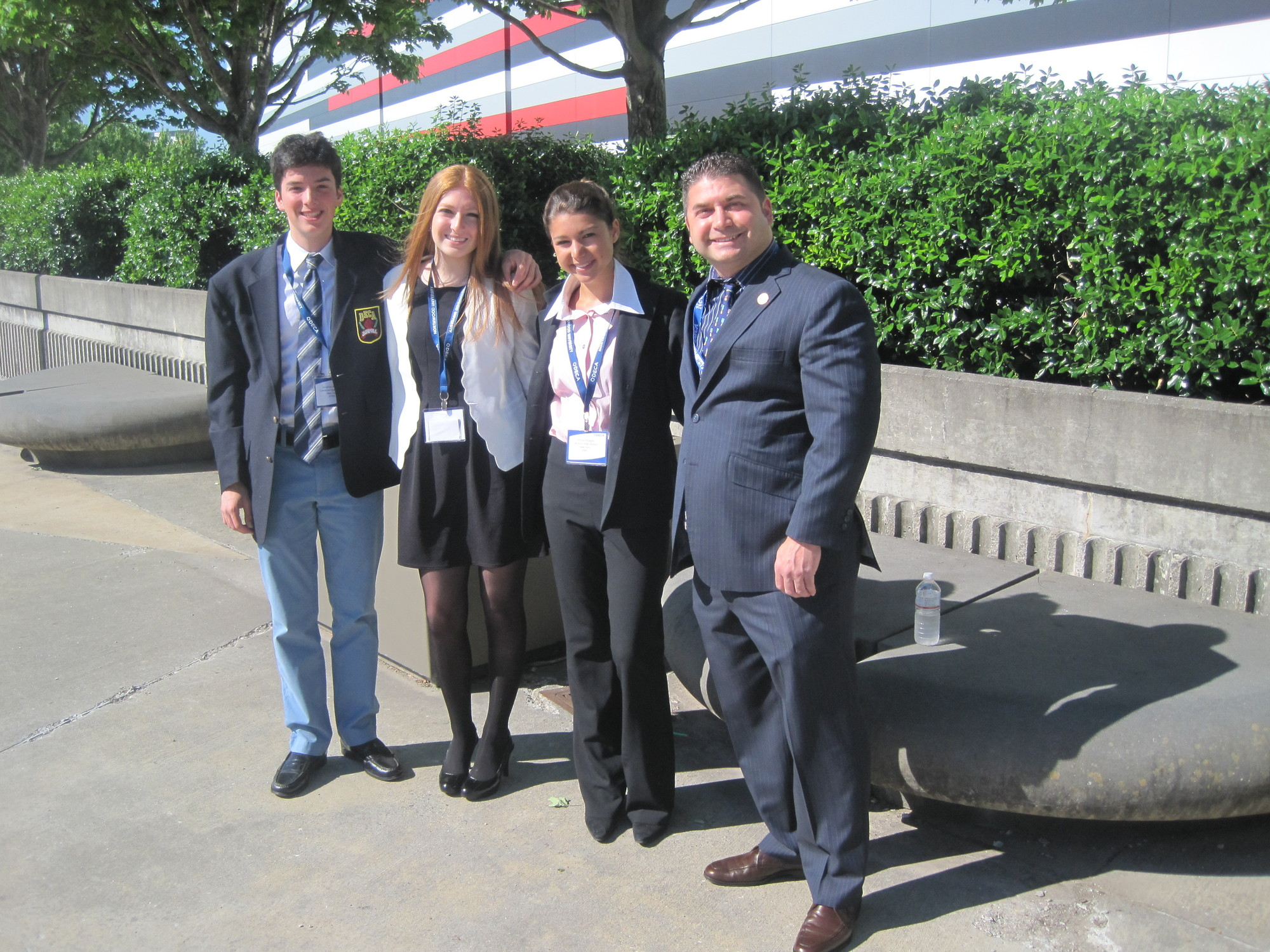 Lawrence High School students have had success at DECA competitions, including this year's fourth place finish by Victoria DiCeglio. From left were students Jonathan Rutchik, Jessica Beyer, DiCeglio and advisor Mark Albin.