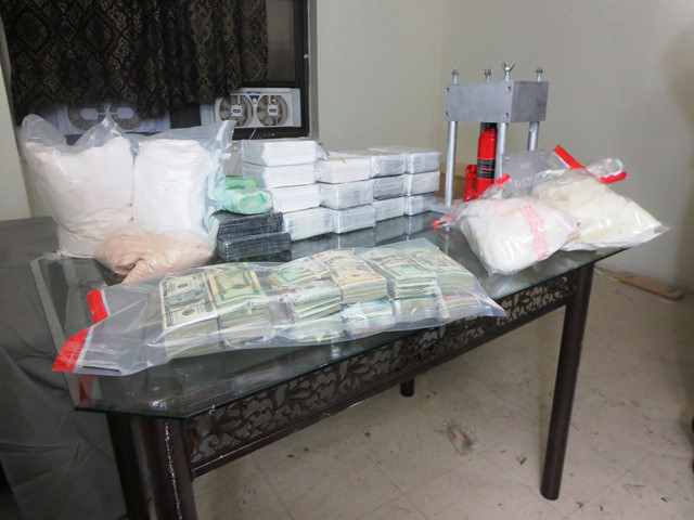 Long Island's heroin trade often starts in New York City, according to law enforcement officials. Above, a cache of heroin and cash seized during a Drug Enforcement Administration sting in the city in April.
