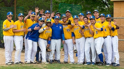 East Meadow baseball players celebrated with coach Ken Sicoli after his 500th career victory, a 13-inning playoff win over MacArthur, that concluded on May 14.