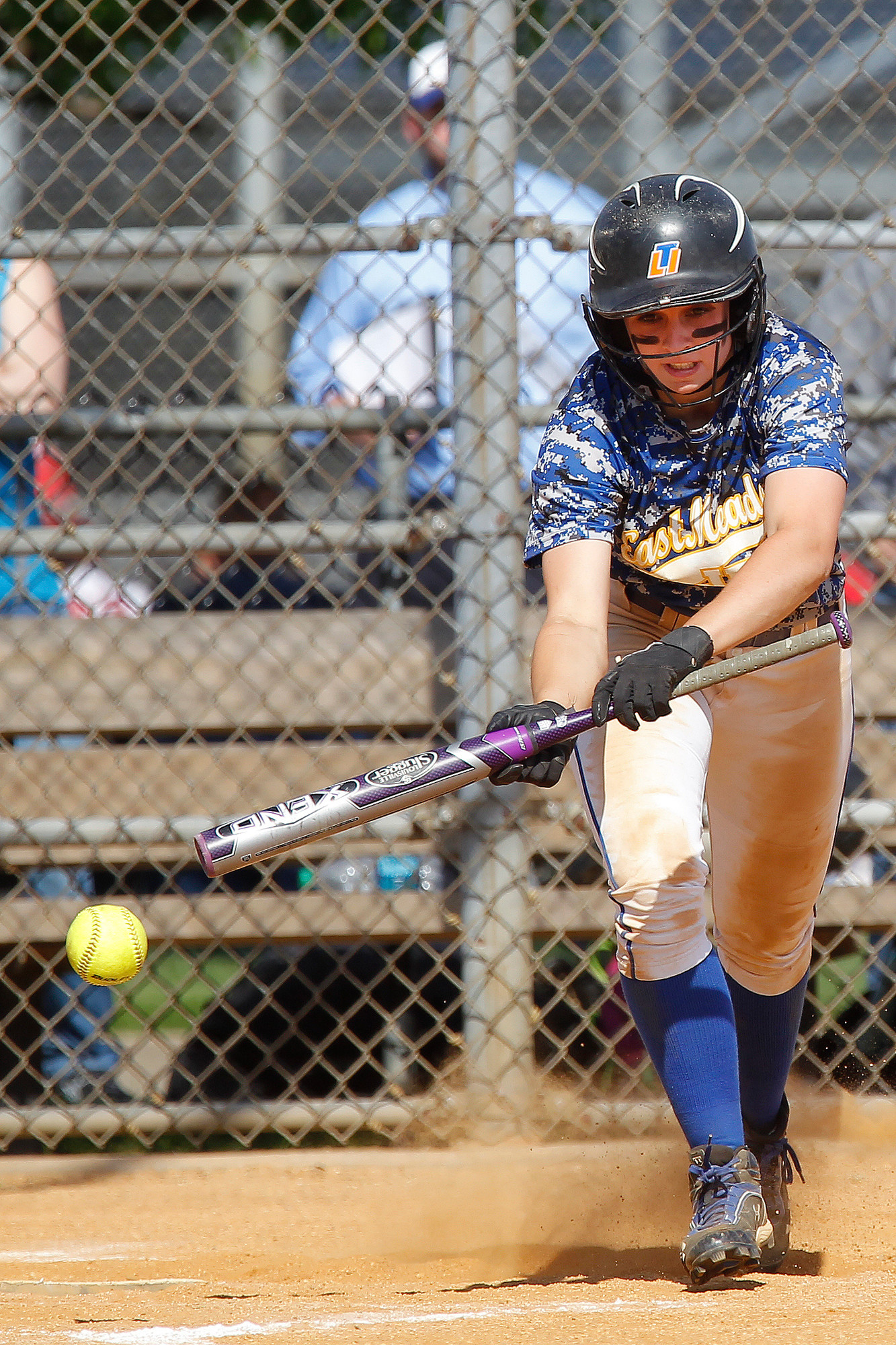 East Meadow's Claire Travis drops down a bunt during Game 2 of the Nassau Class AA championship series on May 20.