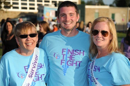 Co-chairs Laurie Faust, left, and Kelly Murray, right, with Chris Tellarico, of the American Cancer Society.