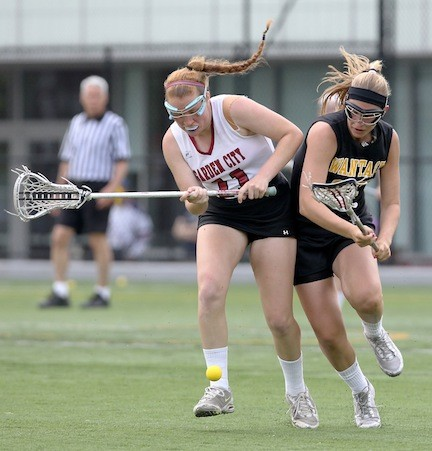 Wantagh's Stefanie Wenz, right, battled Garden City's Kayla Murphy for a loose ball during a Nassau Class B semifinal game.