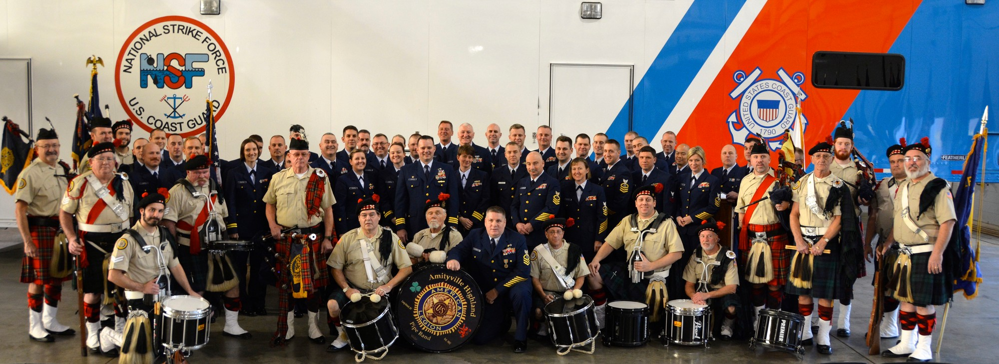 Chief Sean Lynch, kneeling in center, with his Atlantic Strike Team Unit shipmates and members of the Amityville Highland Pipe Band.