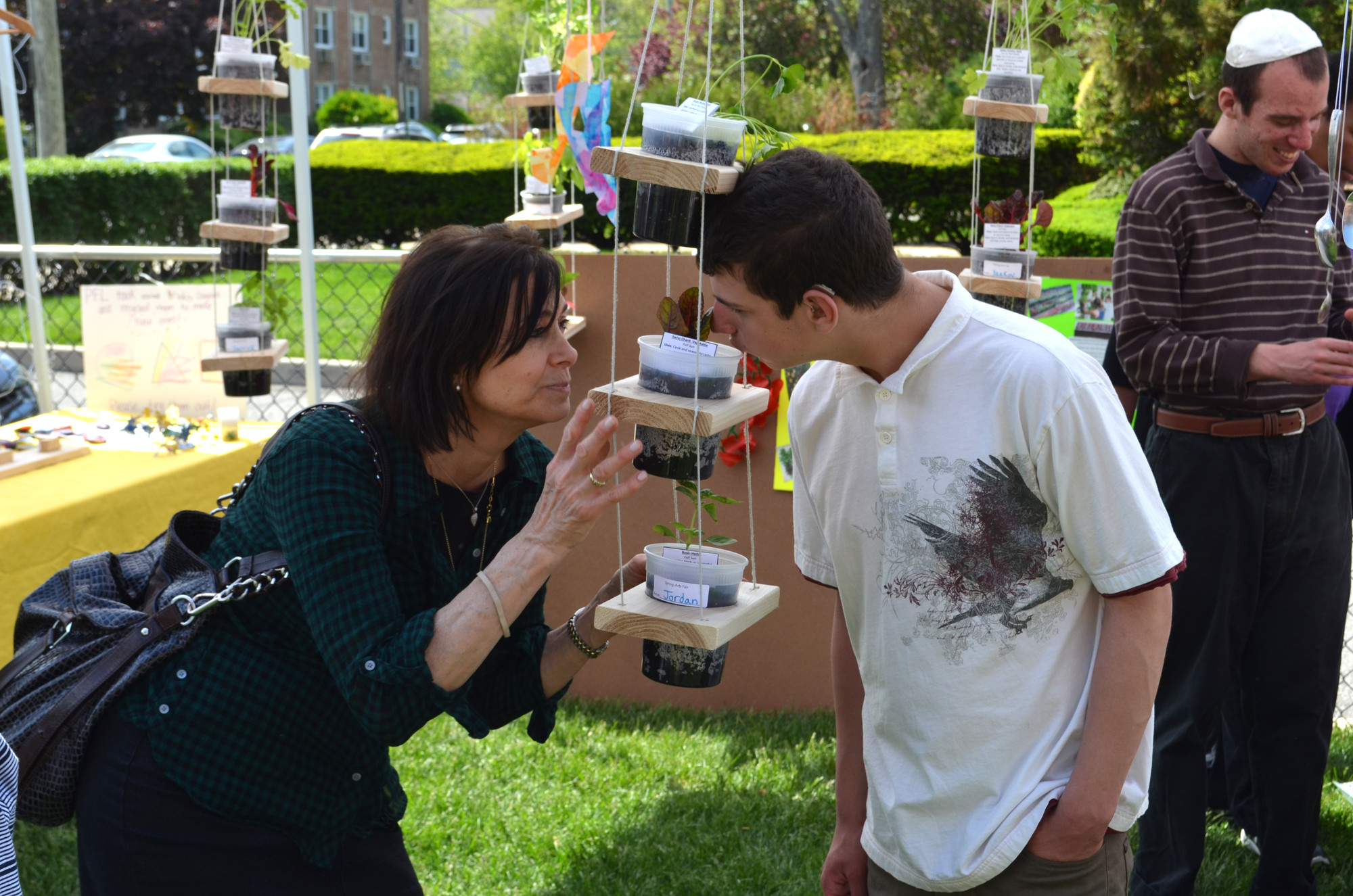 Kulanu's spring arts and science festival engaged the senses as speech therapist Dena Goldblatt and Isaac G., 15, smelled the basil.
