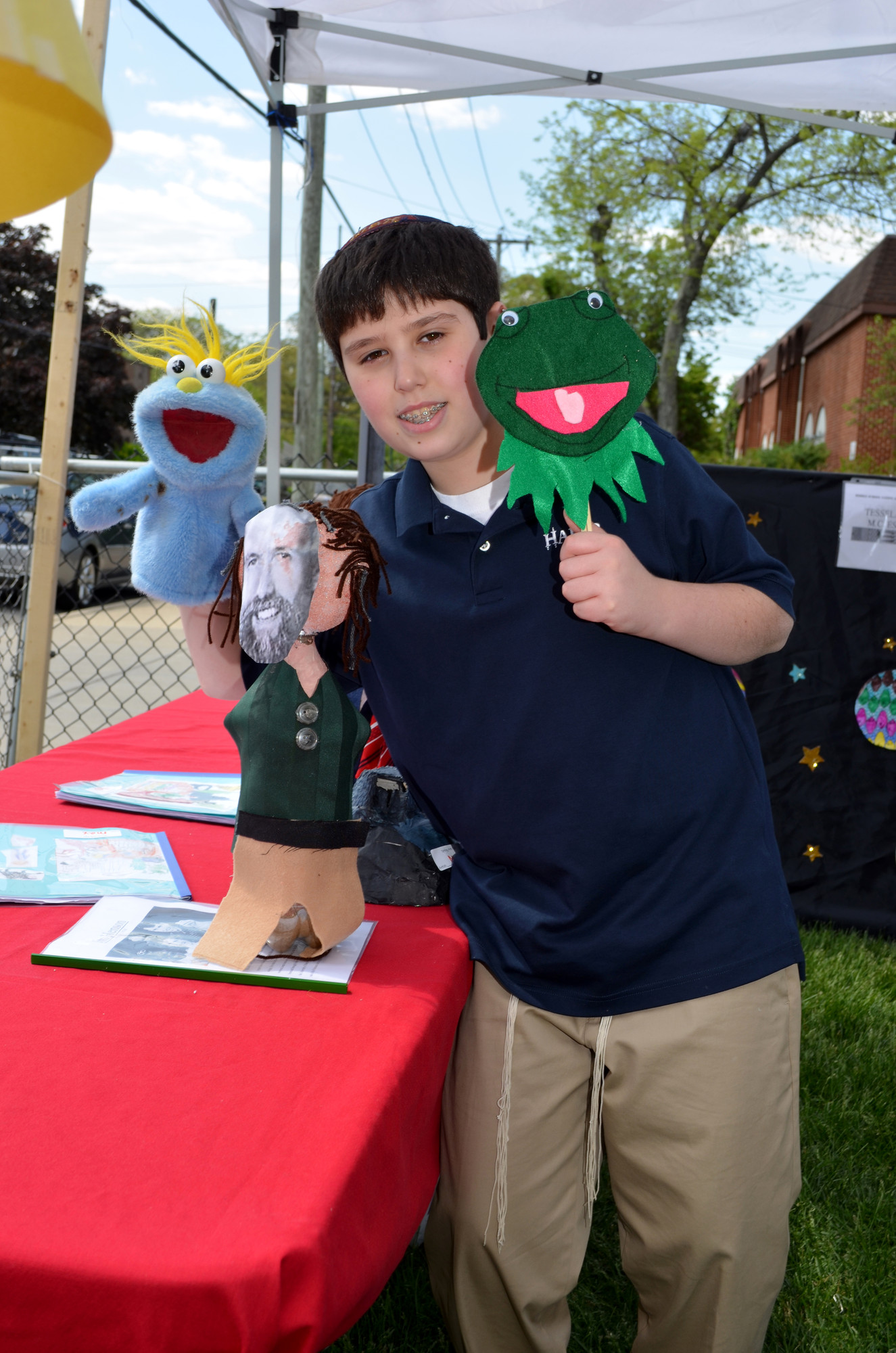 Maxwell Tepler, 13, displayed his project: puppets of Muppet creator Jim Henson and Henson's famous creation Kermit the Frog.