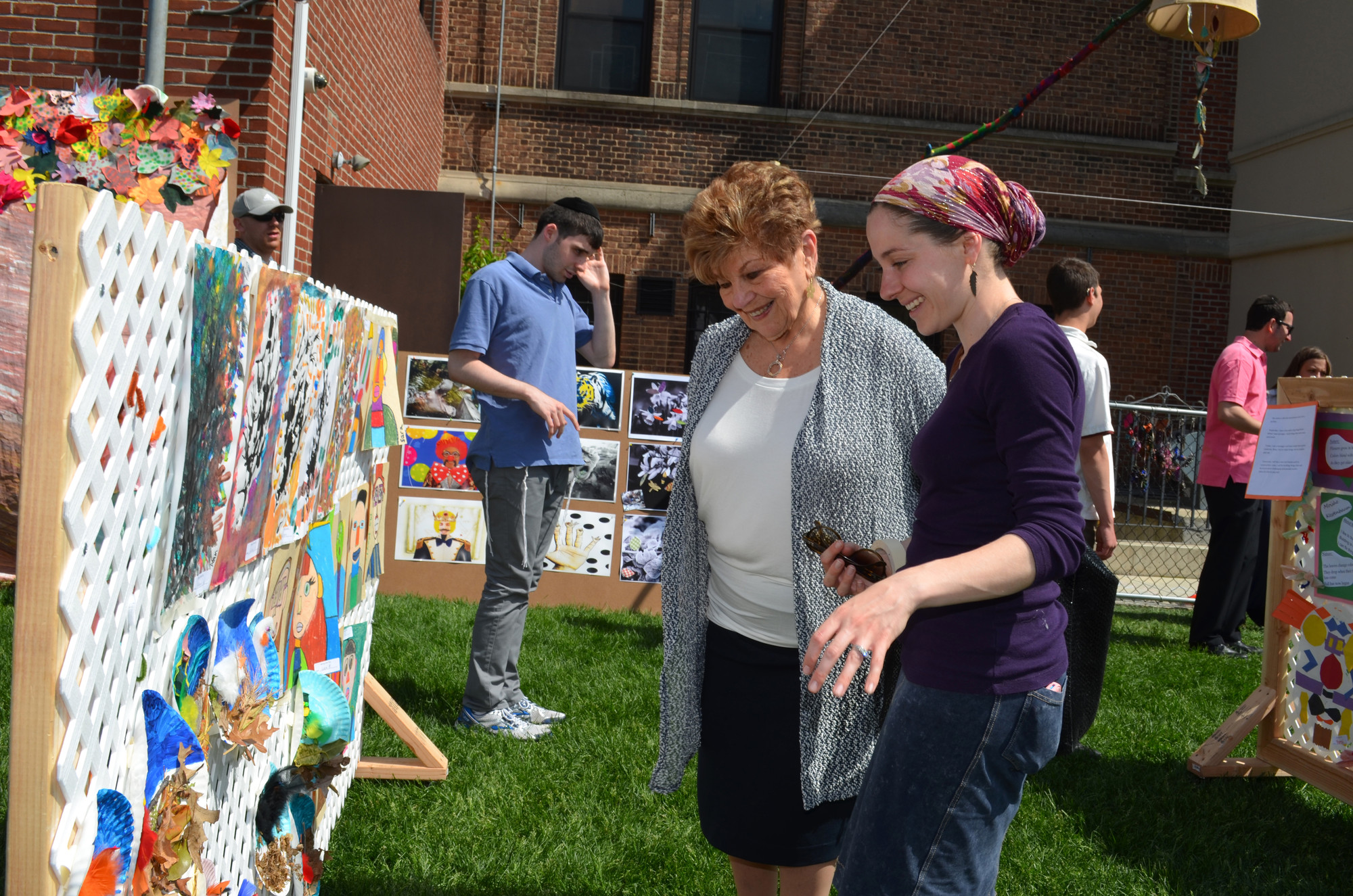 Art therapist Sara Haimoff with her grandmother, Elaine Rosengarten, left, viewed the art work at Kulanu's festival.