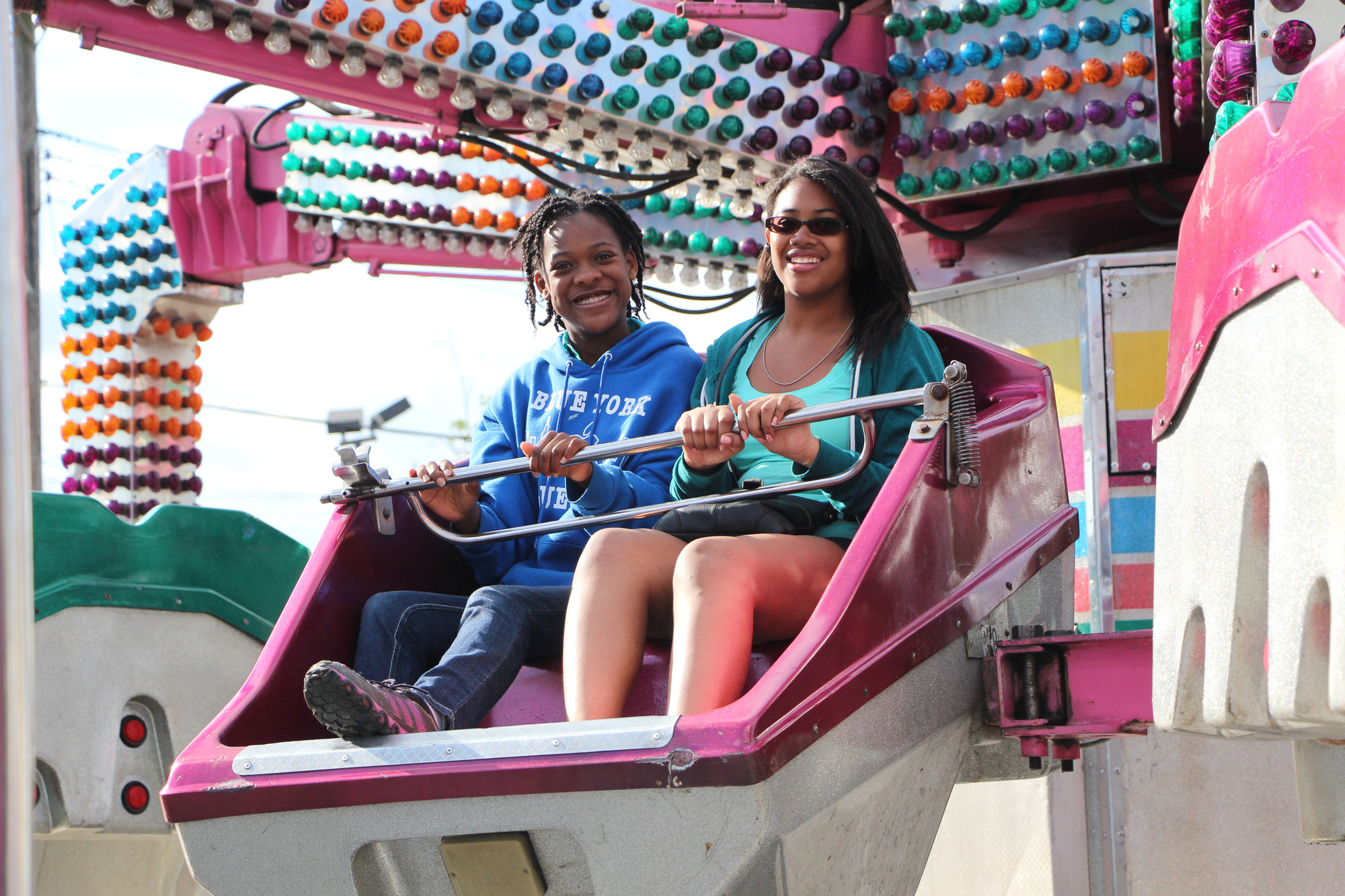 Mia Jean-Louis, 14, left, and Joelle Nicolas, 14, took a ride on the Twister last weekend under sunny skies.