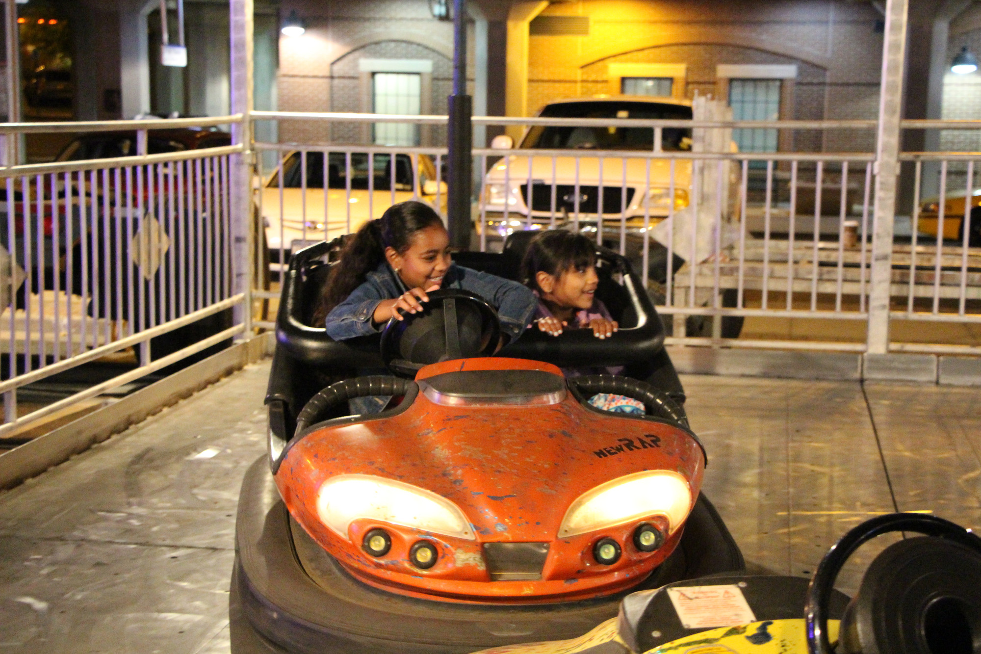 Sisters Valanie, 8, left, and Dezirae Wishropp, 6, drove bumper cars at the Baldwin Chamber of Commerce carnvial, which was held from May 29 to June 1 at the Long Island Rail Road station.