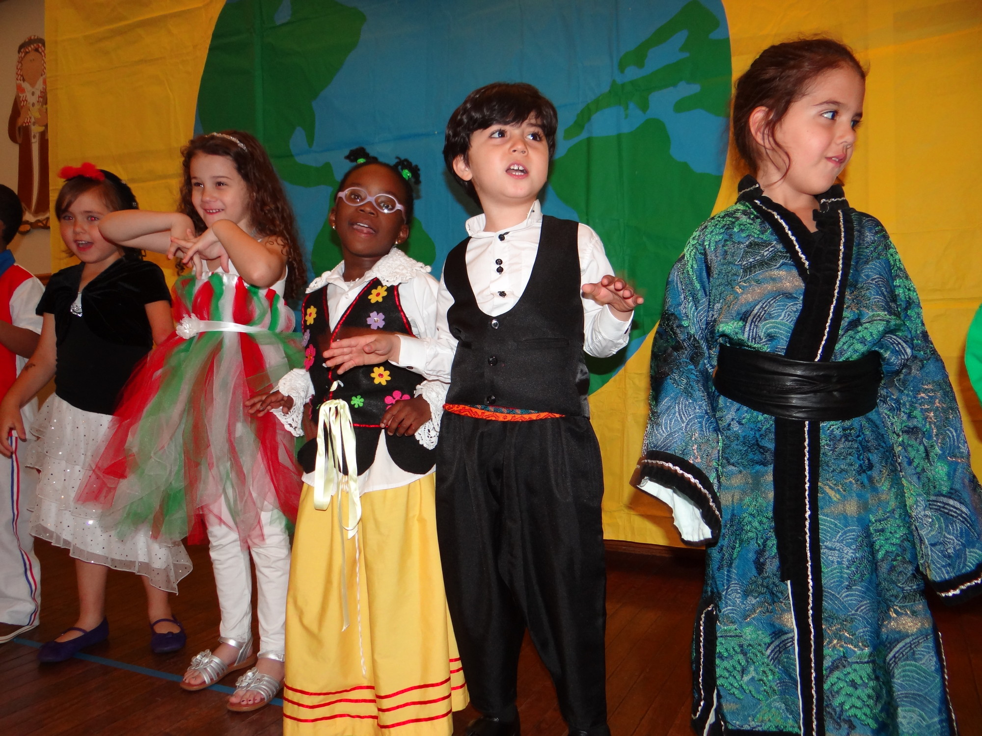 Students dressed up and sang songs for family members in attendance during the Community Nursery School of Baldwin's international show on May 22.