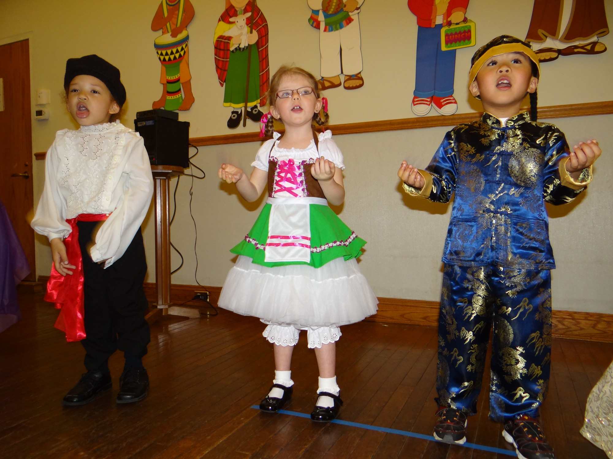 Jovan Brafman, 4, left, represented Russia, Scarlett Demmerle, 4 took on the role of Gemany, and AJ Velasco, 4, represented Japan.
