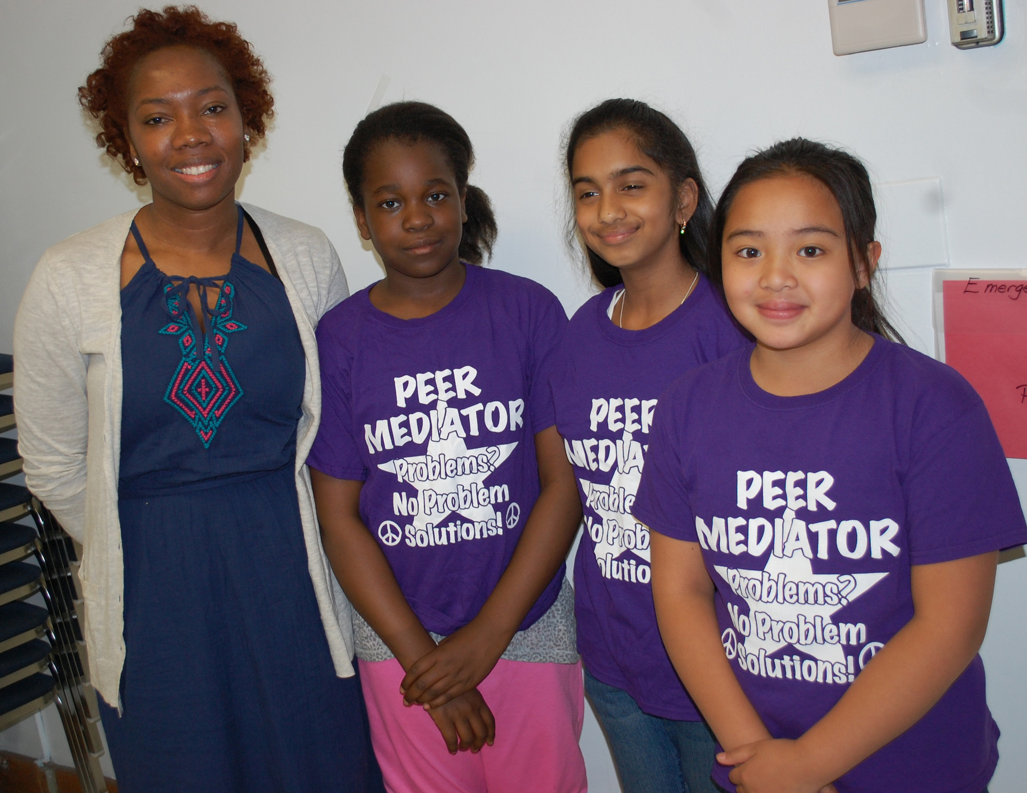 Forest Road School psychologist Sonya Jackson is joined by peer mediators Tia Walker, Ameena Qadri and Sophie Longid.