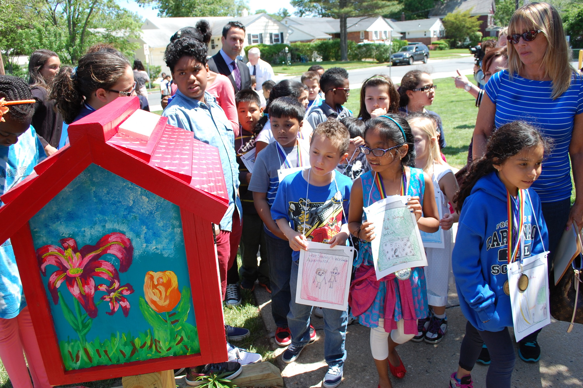 Carbonaro School students, after marching in a character parade, got to see the Little Free Library at its permanent home alongside the front walkway.