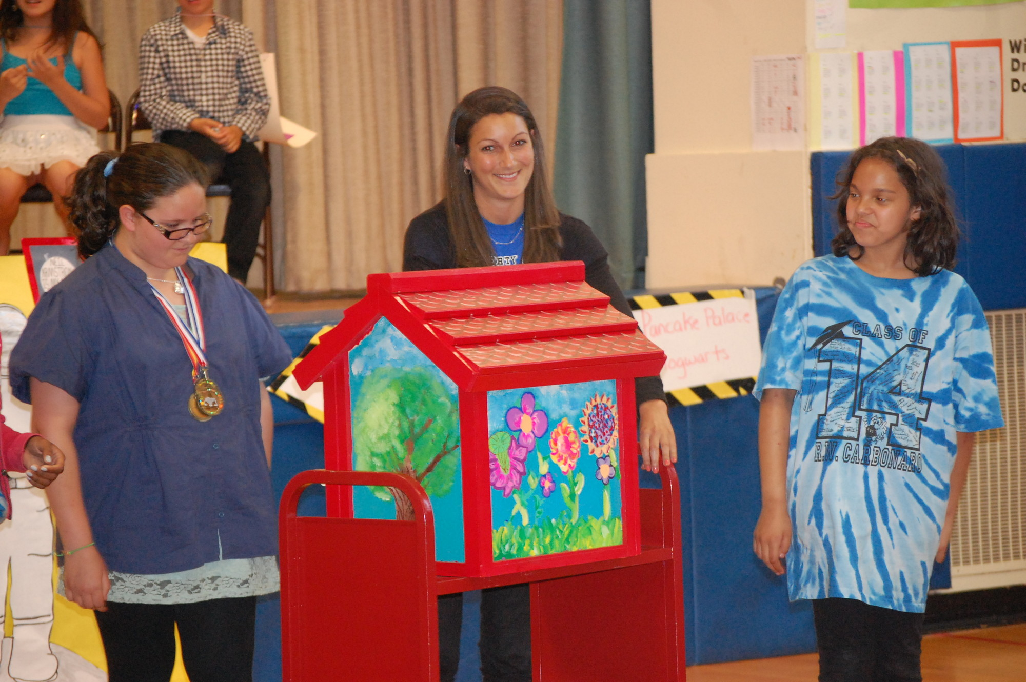 Art Teacher Jessica Garfinkel, center, and students from the Robert W. Carbonaro School art club presented the Little Free Library on May 29.