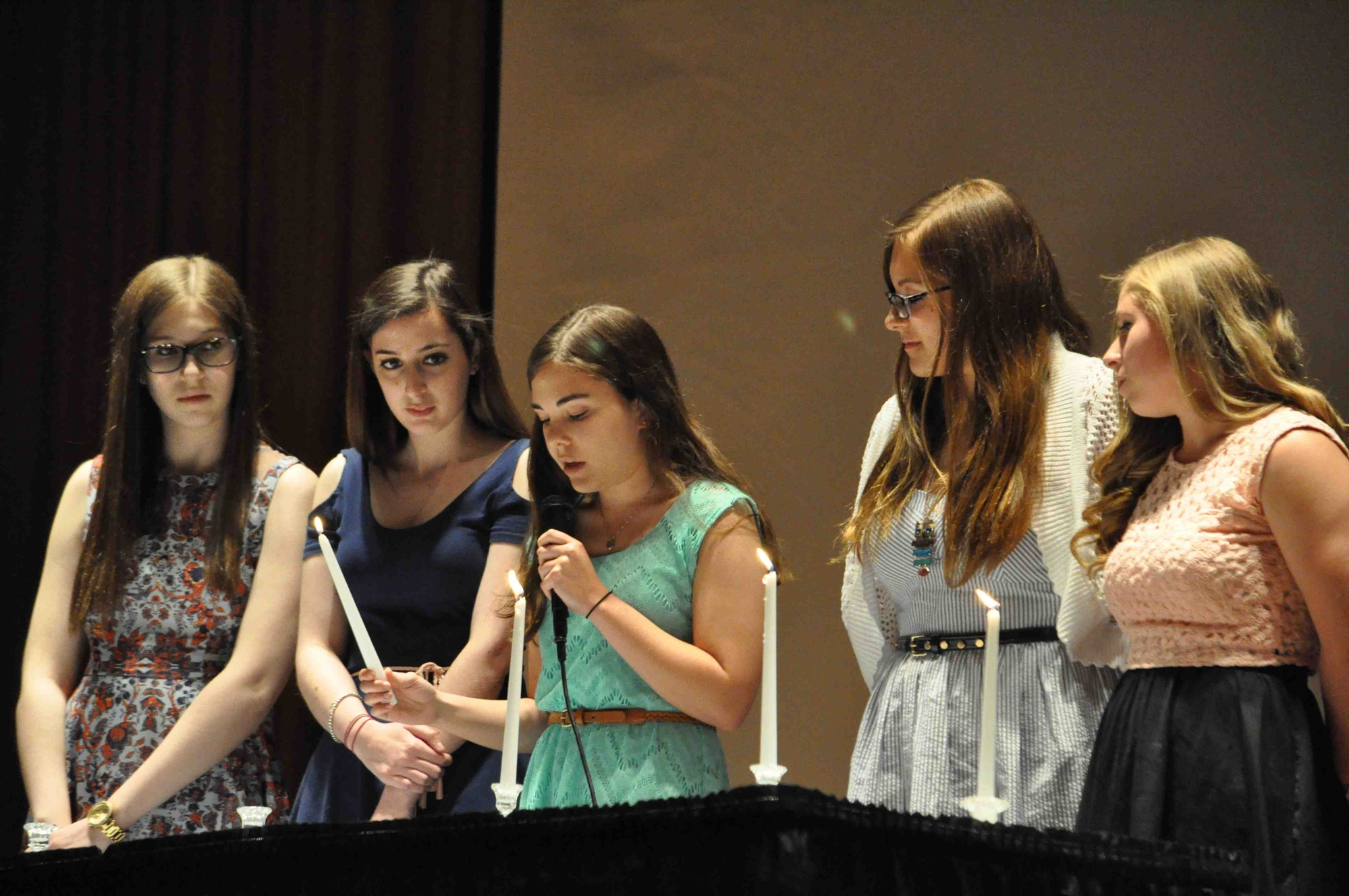 Beatrice Brown (Kennedy), Alix Kozin (Calhoun), Rachel Ross (Calhoun), Erica Miller (Mepham) and Kiara Kaylor (Mepham) lit candles symbolizing the four pillars of the New York State Science Honor Society during an induction ceremony on May 19.