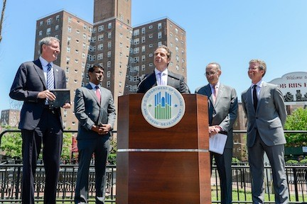 Governor Andrew Cuomo, center, was joined by New York Mayor Bill DeBlasio, left, Vice President for Initiatives and Strategy of the Rockefeller Foundation Zia Kahn, U.S. Senator Charles Schumer and HUD Secretary Shaun Donovan to announce the winners of the Rebuild by Design competition.