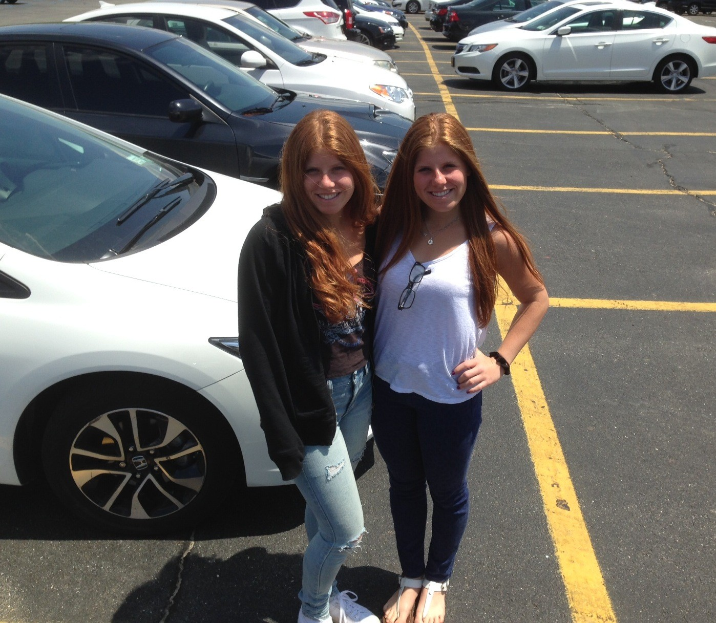 Anna and Emily Lawrence, 17, juniors at Kennedy High School in Bellmore, have organized an anti-texting-and-driving campaign that they're calling STANDD-NY (Stop Texting and Driving-New York). Above, the twins in the Kennedy student parking lot.