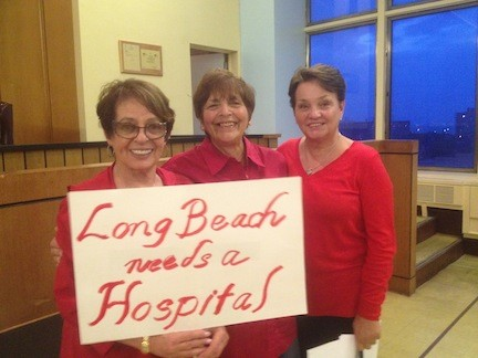 Residents Phyllis Libutti, left, Barbara Bernardino and Linda Giles wore red in a show of solidarity on Tuesday.