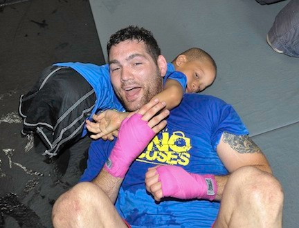 Isaiah Bird, left, brought UFC middleweight champion Chris Weidman to the mat.