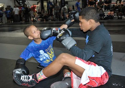 At age 6, Bird, left, is already a top wrestler. He sparred at last Sunday's fundraiser, hosted by  Weidman at his East Garden City gym.