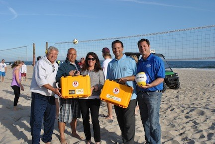 Kevin Killarney, far left, owner of Evolutions Volleyball; John Colletti, Anthony Cavallo's friend and teammate; Heather Cavallo, Anthony's wife; City Councilman Anthony Eramo; and Paul Ferrante, assistant superintendent of Parks and Recreation, on Edwards Boulevard beach on May 29.