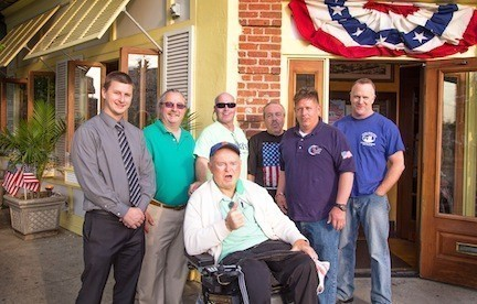 Billy Papetti, far left, Rich Papetti, U.S. Army veteran Jim Monahan, Waterfront Warriors Co-chair Jerry Snell, U.S. Navy veteran Paul Seiven, Waterfront Warriors Co-chair Jamie Lynch and U.S. Marine veteran Mike Willett at the Waterfront Warriors fundraiser on May 19.