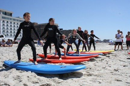 The surf students prepared on the sand before heading to the water.