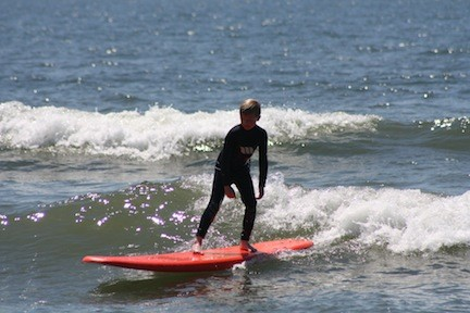 Nate Aronowsky, 8, of Greenlawn, was the first to catch a wave.