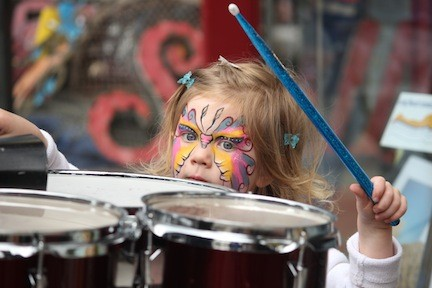 Tara Sullivan, 3, gave the drums a try.