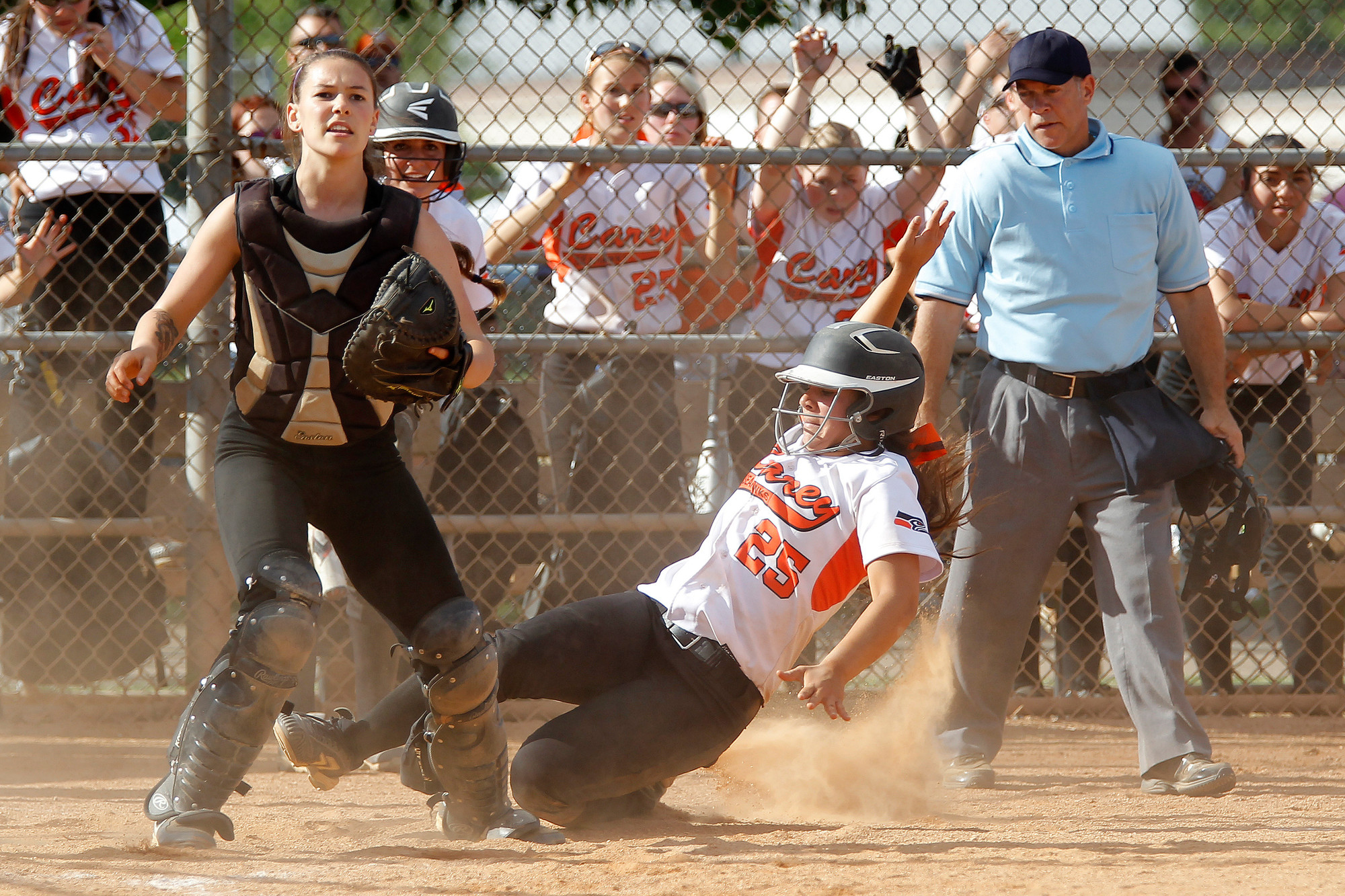 Carey's Rebecca Vilchez, who opened the scoring in last Friday's L.I. Class A championship game with a homer over the fence, slid home with another run in the fifth.