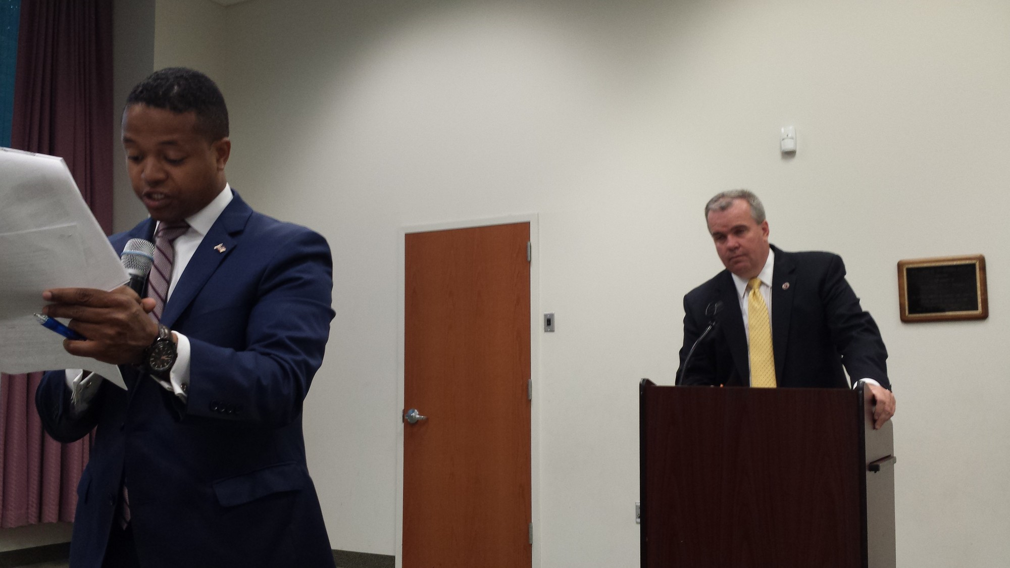 County Legislator Carrie Solages (D-Elmont), left, addressed community members at a meeting he hosted at the Elmont Library on June 3 as Acting NCPD Commissioner Thomas Krumpter looked on.