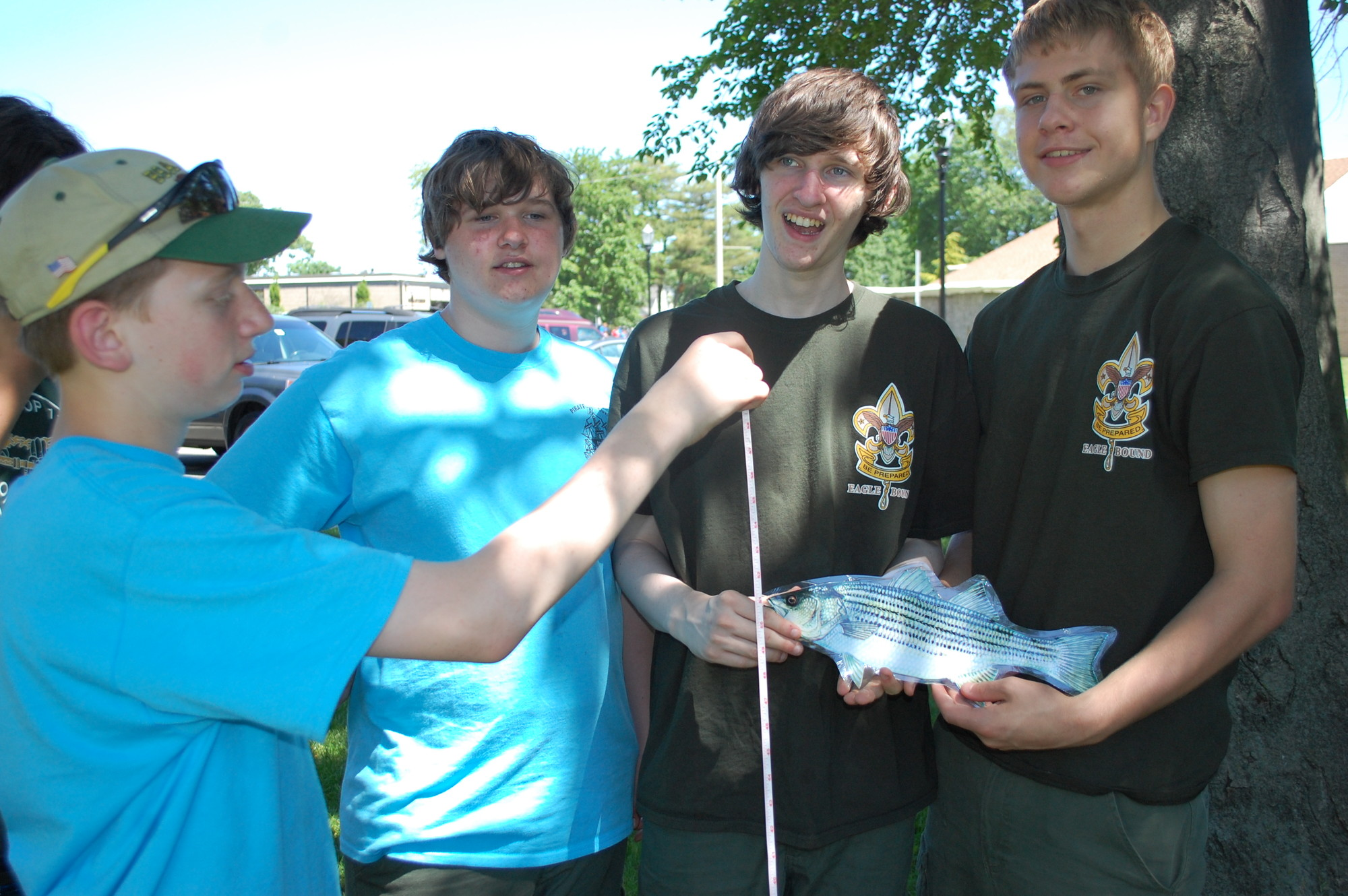 Troop 116 Boy Scouts, from left, Jason Bitteto, Chris Raffloer, Billy Raffloer and Ryan Plackis learned about fish.