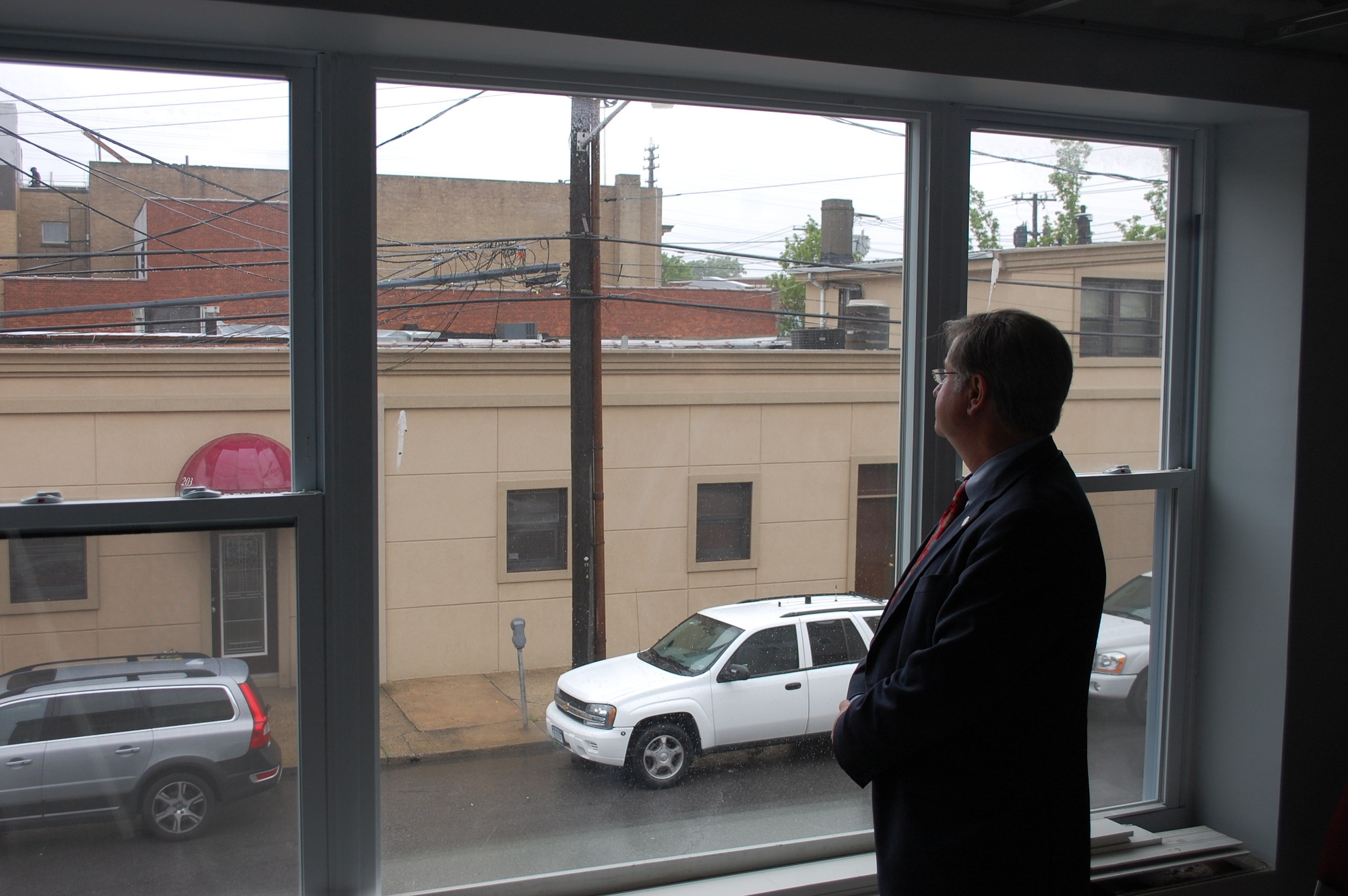 Village Justice Robert Bogle looks out the window from his future office at 195 Rockaway Ave.