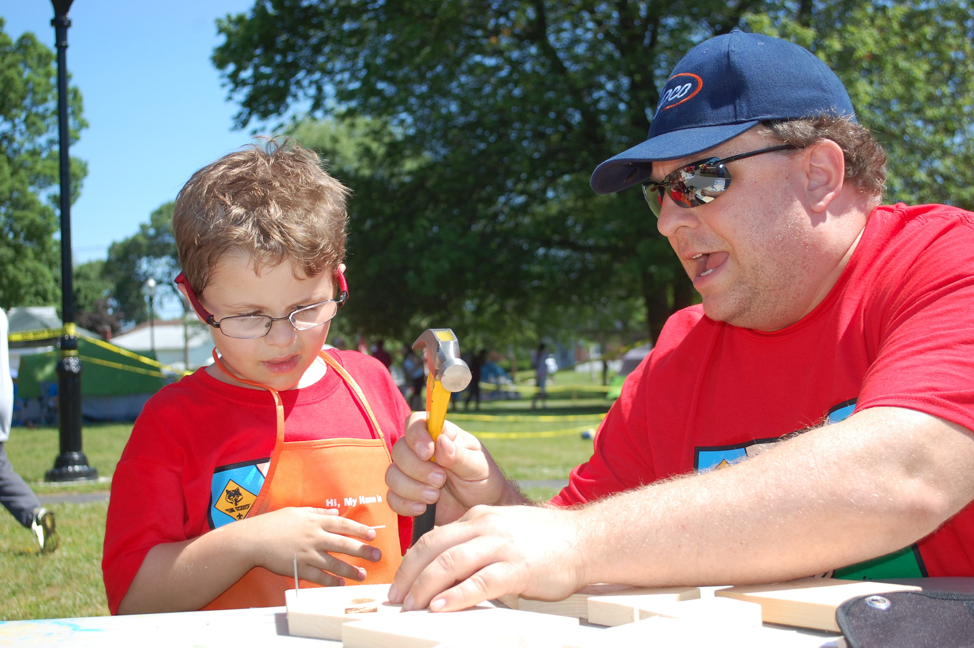 Sean Leon, 6, a Cub Scout from Pack 367, got some help from his father, Shawn, in building a birdhouse at the annual Valley Stream Scout Camporee held last weekend on the Village Green.