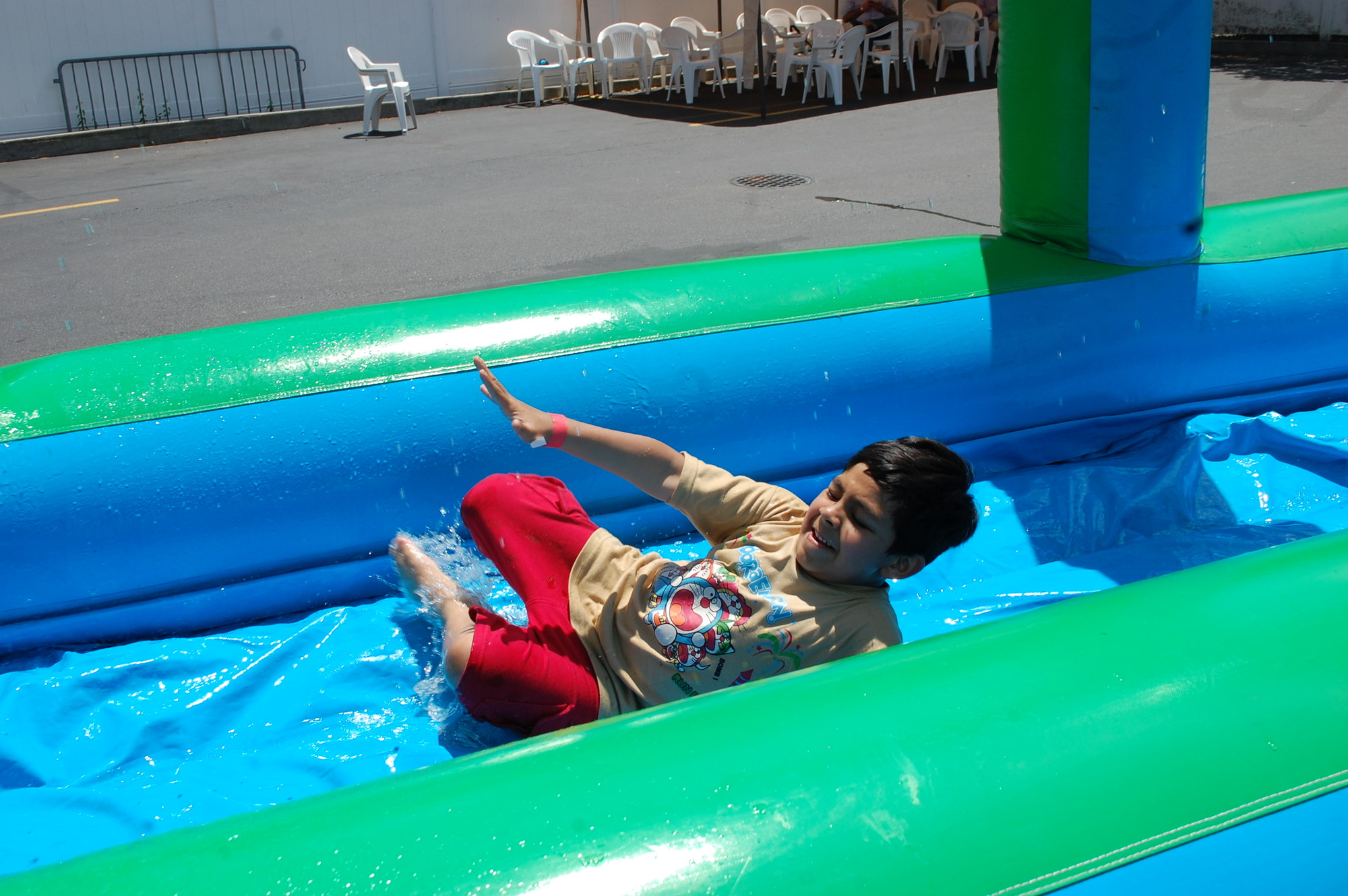 Omar Syed, 6, of Valley Stream, enjoyed the water slide at Masjid Hamza's annual spring fair last Saturday afternoon.