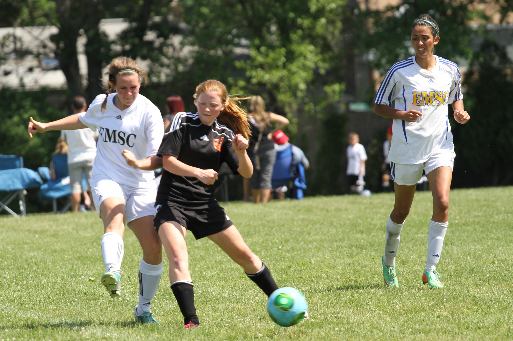 Megan Fischer, left, and Paige Werlau battled for a loose ball at Speno Park.