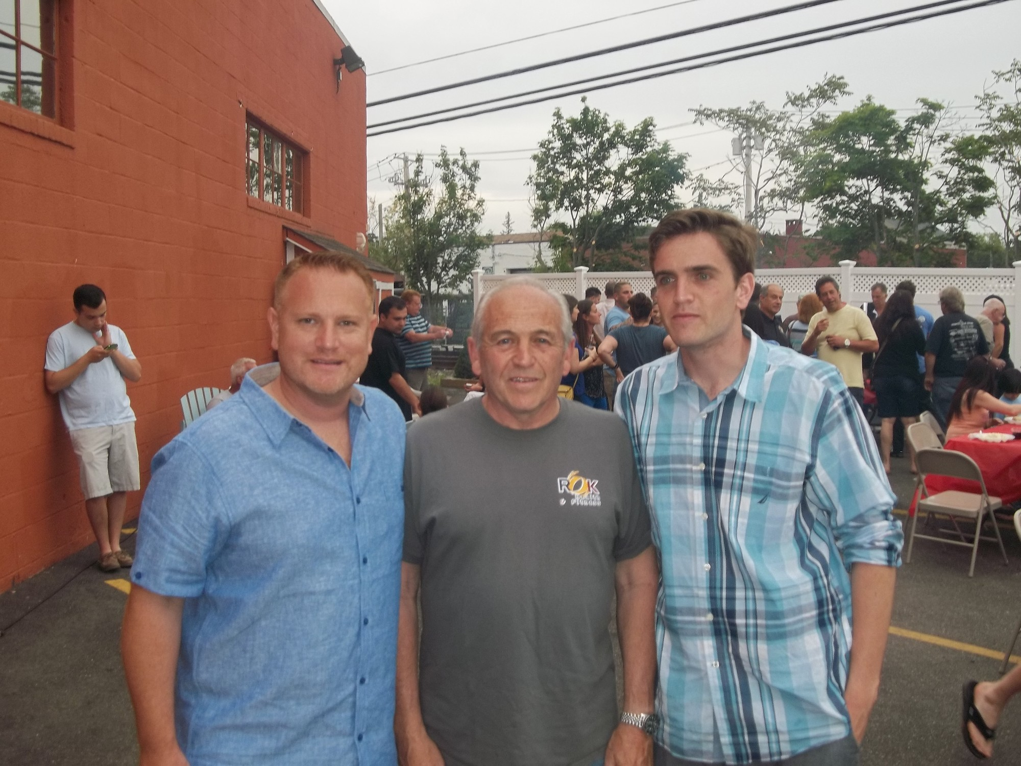 ROK Owners Michael Hawksby, left, Bob D'Urso, center, and Director of Operations Craig D'Urso plan two parties per year to show appreciation the members of ROK Health and Fitness in East Rockaway.