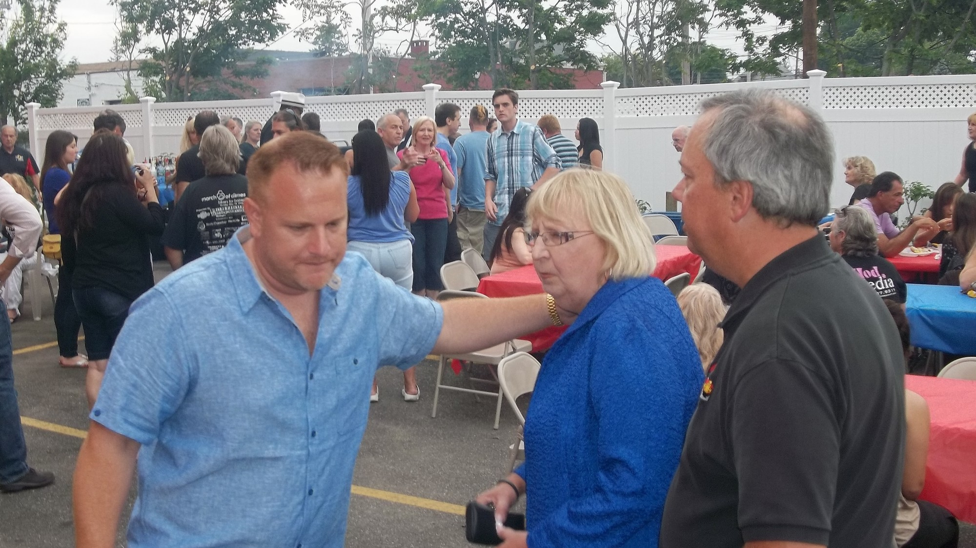 Hawksby greeted Chamber president Debbie Hirschberg and her husband Charlie at the barbecue on June 4.