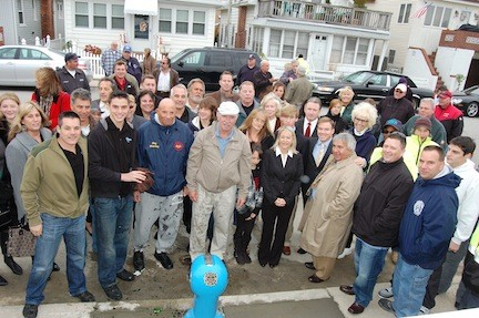 Former City Manager Charles Theofan, third from right, pictured in 2011 at a fire hydrant installation ceremony in the West End commemorating the late Garret Rooney, a former fire chief and assistant city manager.